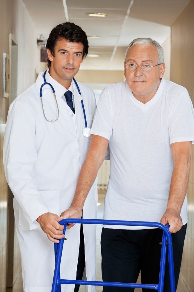 Doctor Helping Old Man His walker