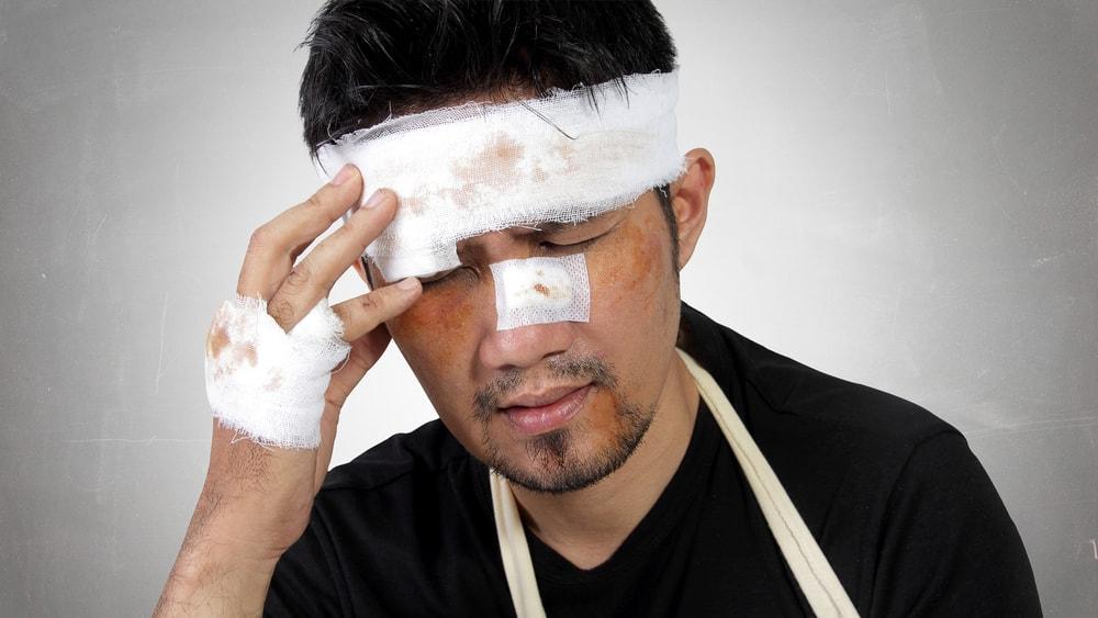 Injured Man Expressing Head Trauma